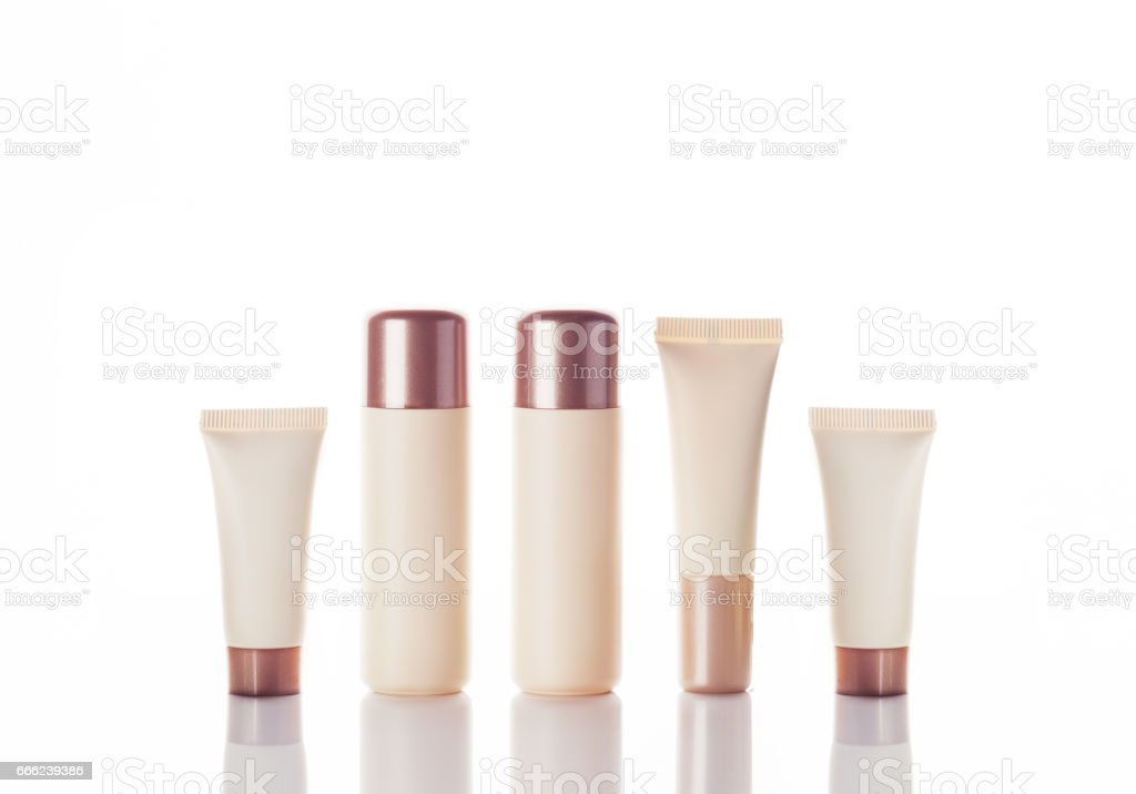empty tubes of cream on a white background with flowers stock photo