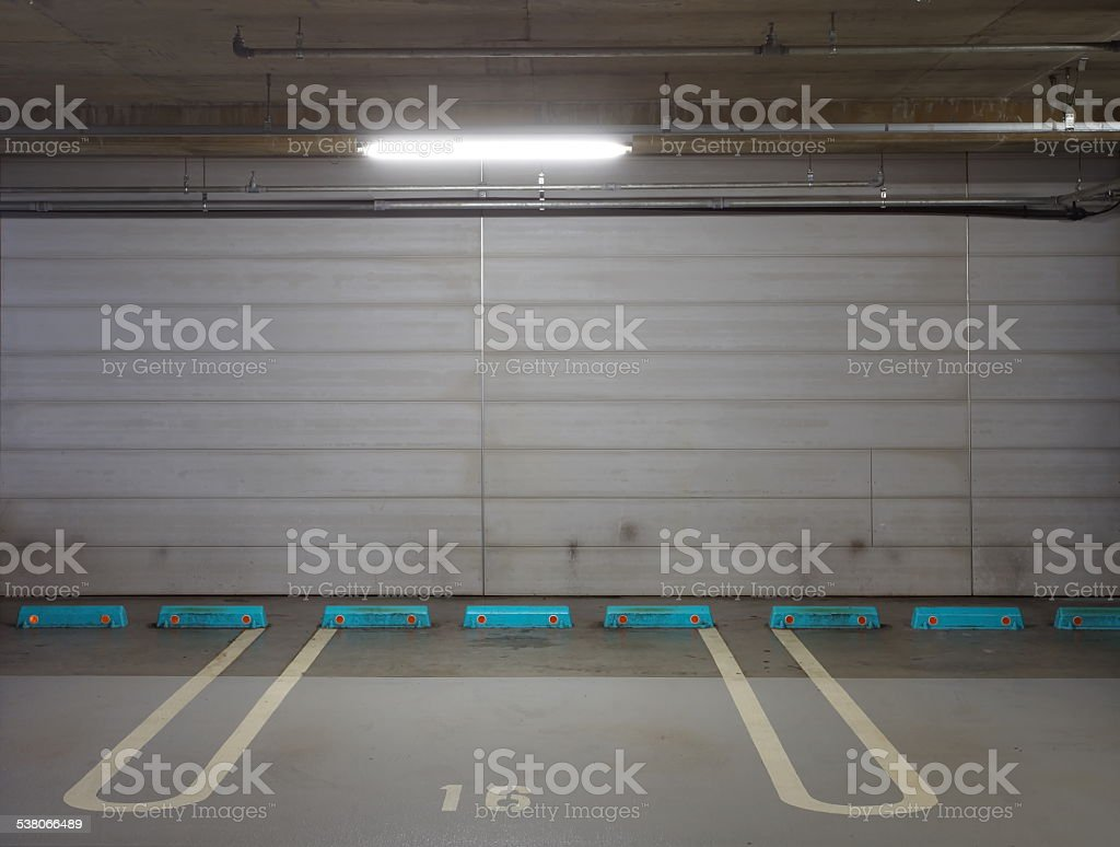 Empty underground car parking space at modern building stock photo
