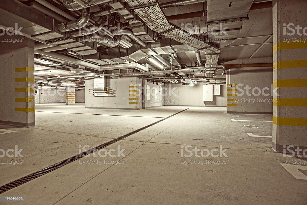 Empty, underground parking garage interior, wiring, air condition, retro style stock photo