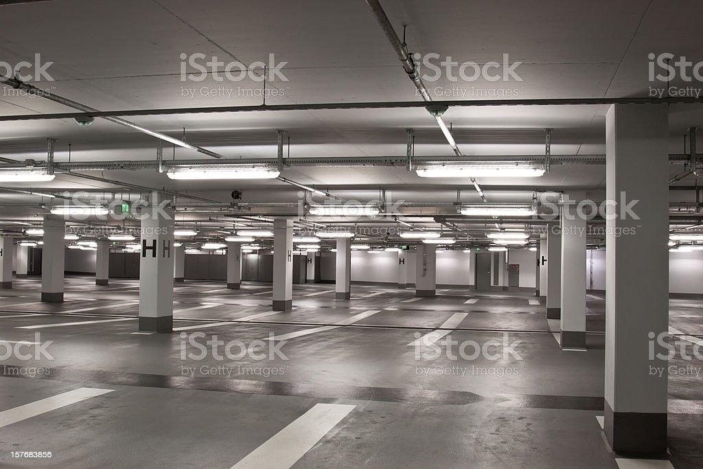 Empty underground parking structure stock photo