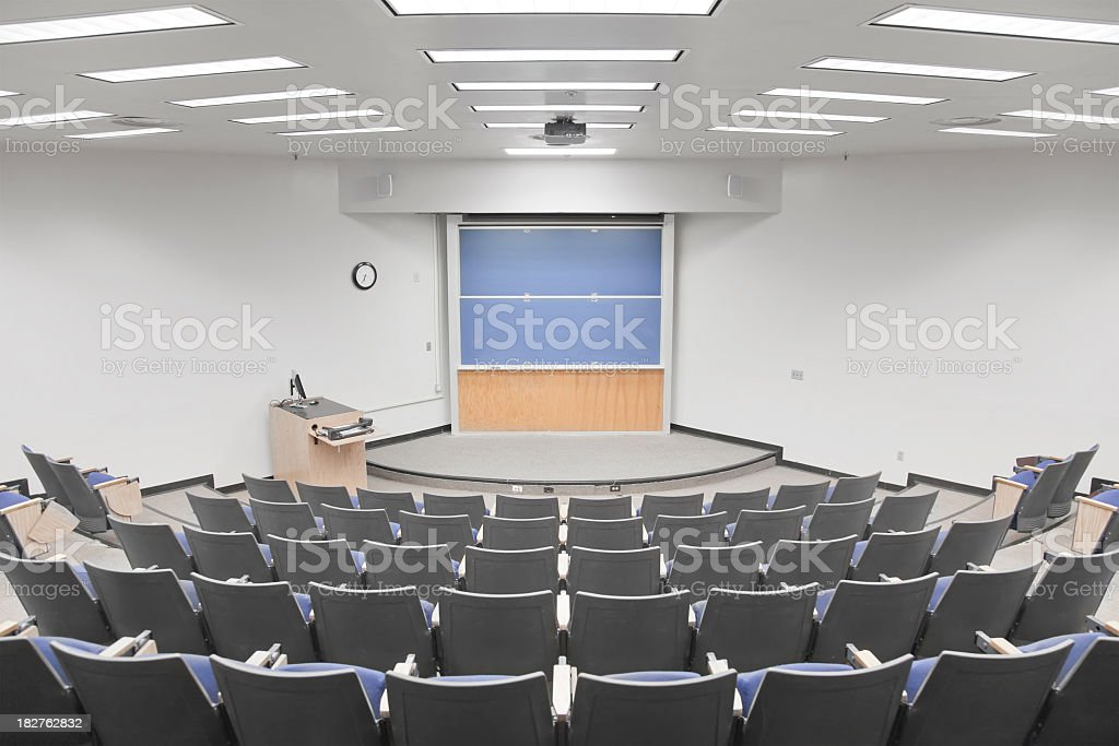 Empty university lecture hall with curved seating royalty-free stock photo