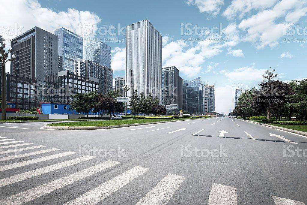 Empty urban road and modern skyline stock photo