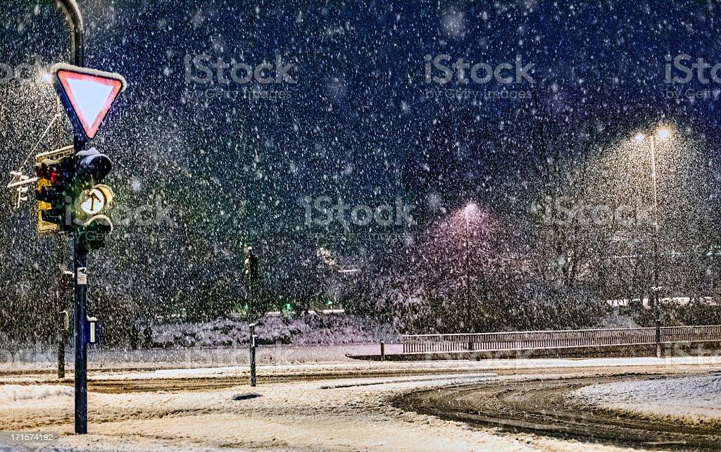 Empty urban road in heavy snow storm royalty-free stock photo