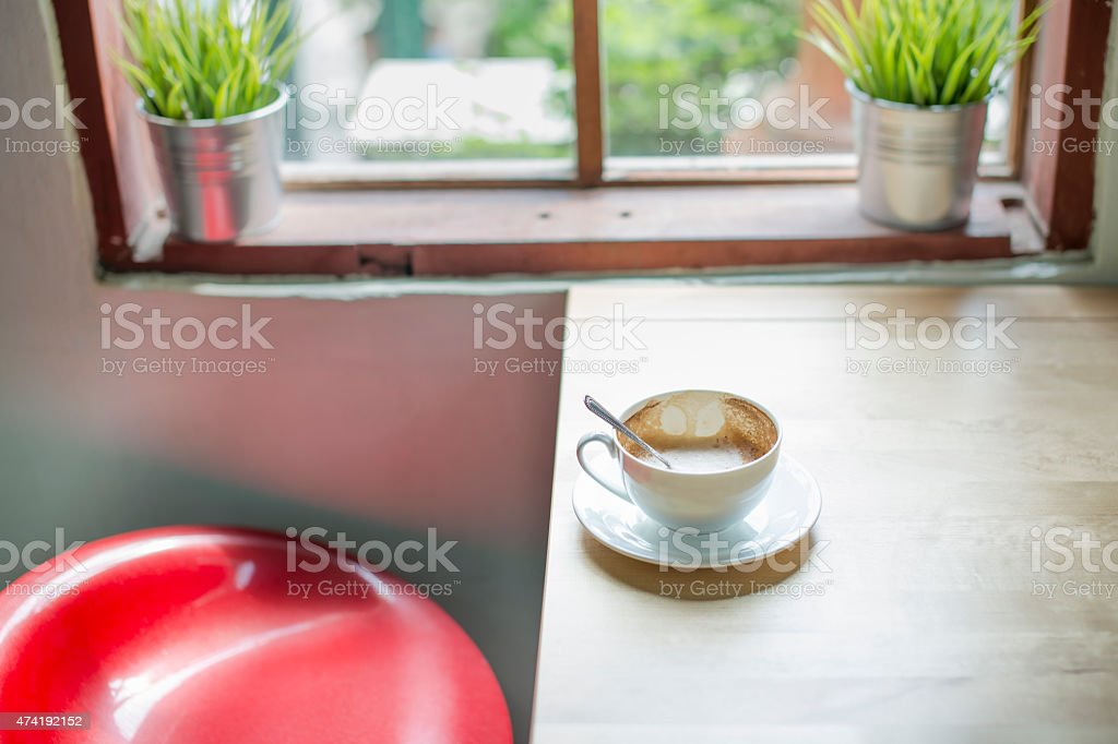 Empty used coffee cup of cappuchino royalty-free stock photo