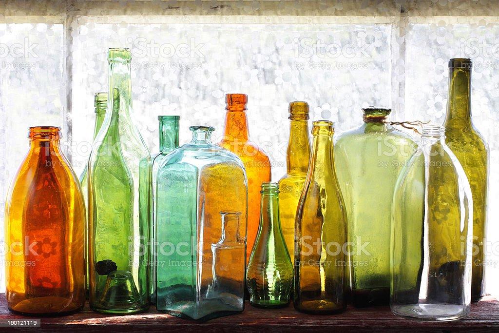 Empty vintage glass bottles stock photo
