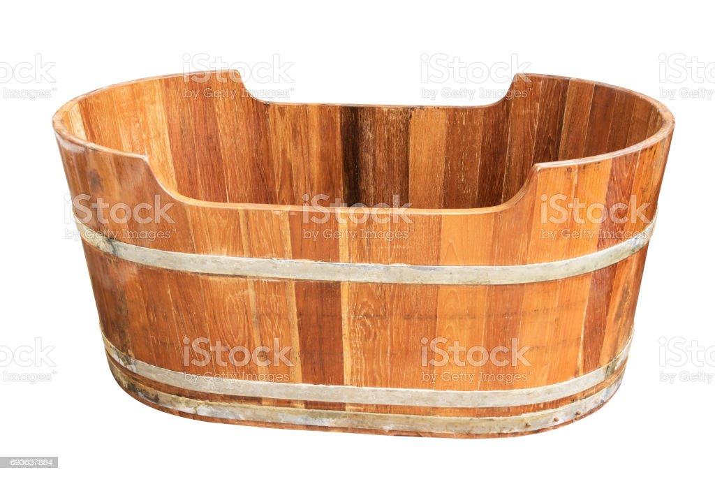 Empty vintage wooden bathtub isolated on white background. stock photo