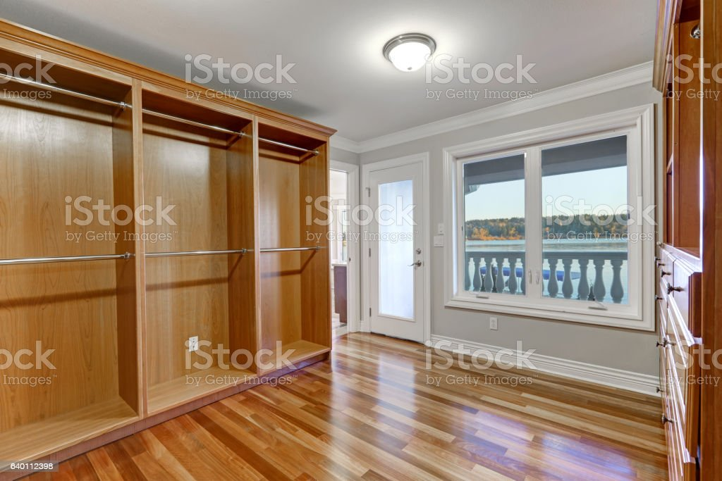 Empty walk in closet with hardwood floor and balcony stock photo