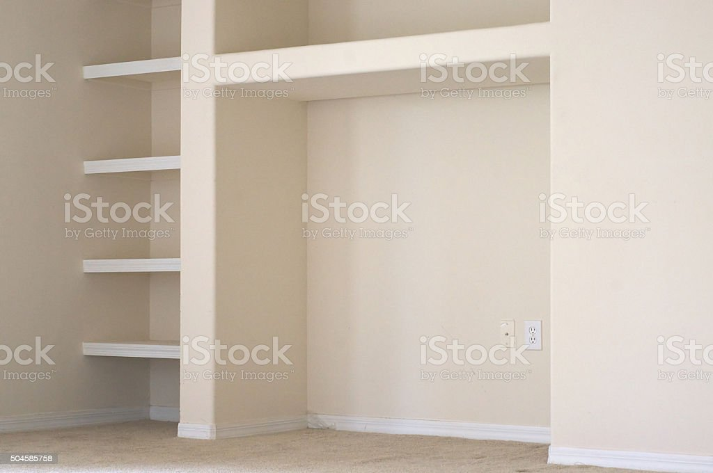 empty wall with built in shelves stock photo