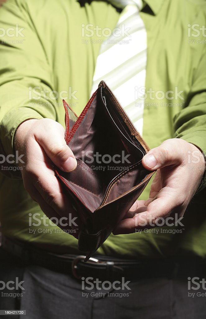 Empty wallet in male hands - poor economy royalty-free stock photo