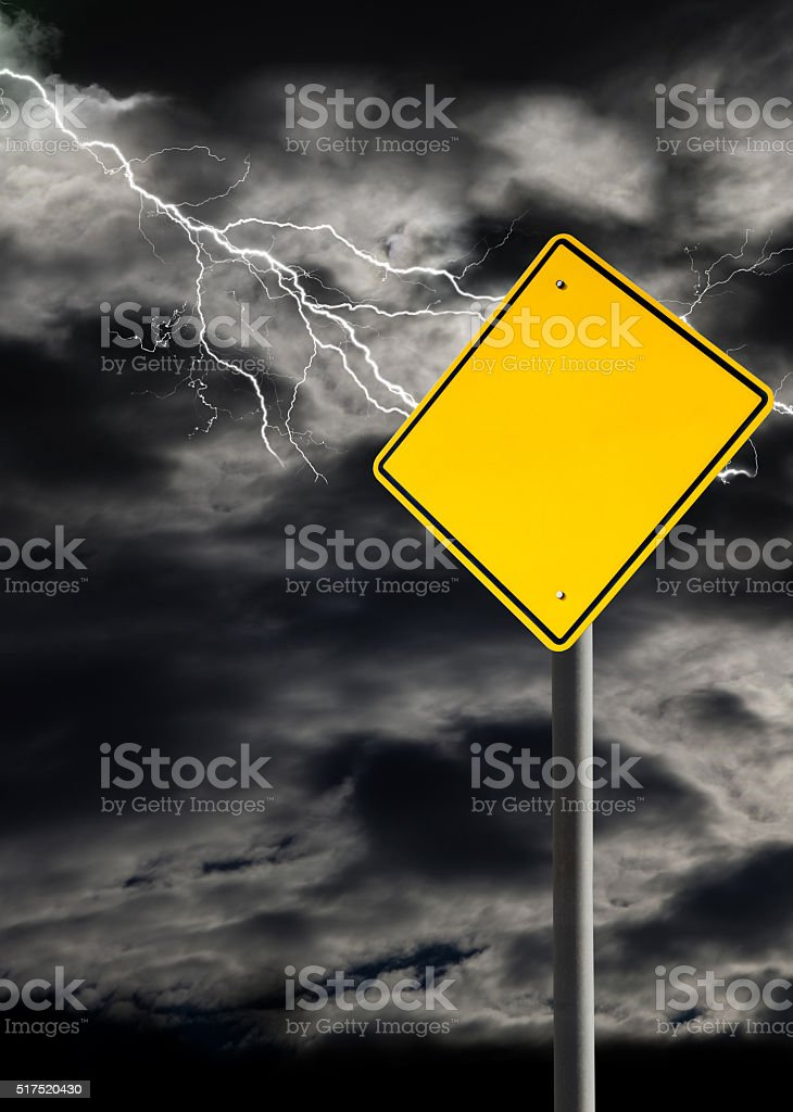 Empty Warning Sign Against Cloudy and Thunderous Sky stock photo