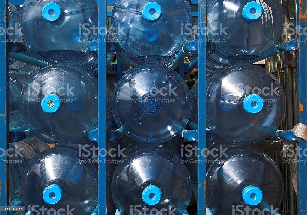 Empty water cooler bottles stock photo
