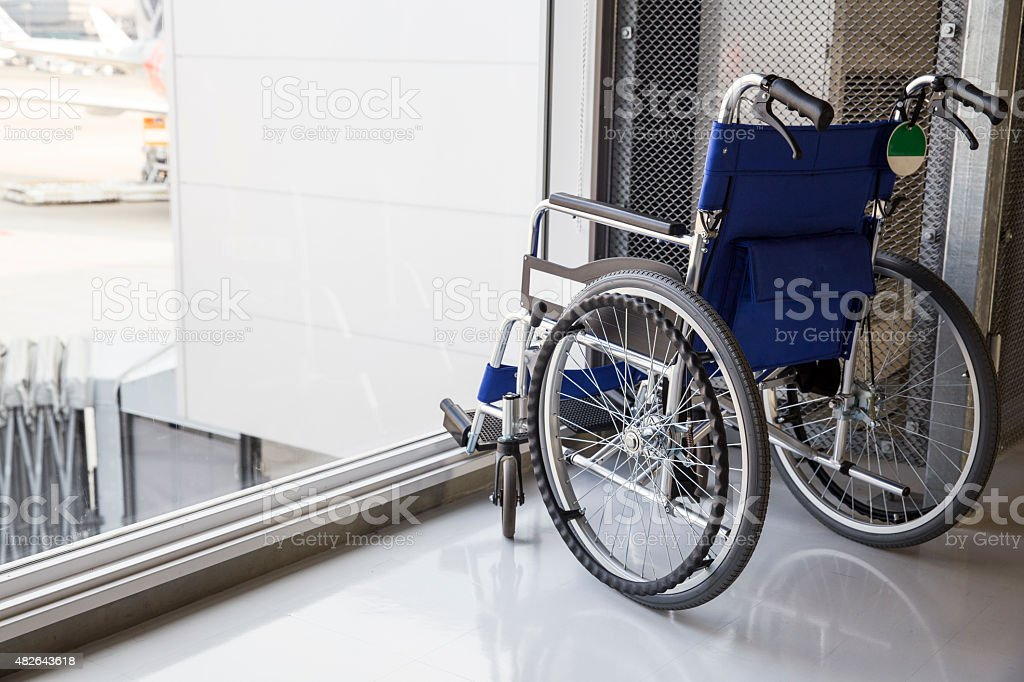 Empty wheelchair parked in airport stock photo