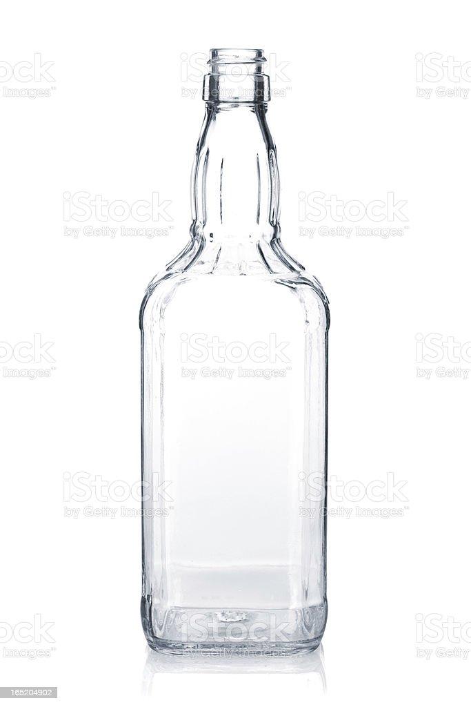 Empty whiskey bottle stock photo