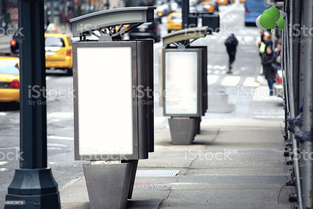 Empty white billboards on two public phone booth stock photo