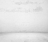 A empty white brick room with rough background