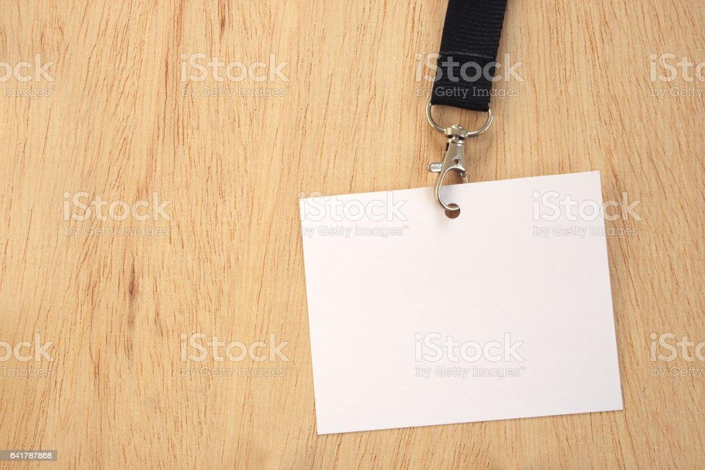 Empty white card on black trade fair lanyard, isolated stock photo