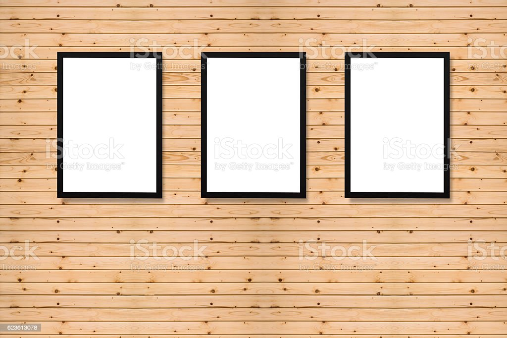 empty white frame with black canvas on pine wooden wall stock photo