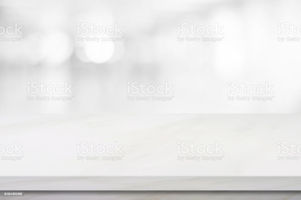 Empty white marble over blur store background, product and food...