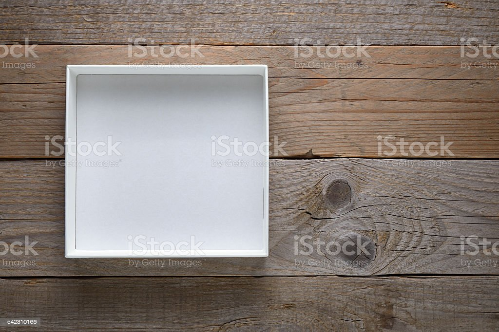 Empty white open box on wooden background stock photo