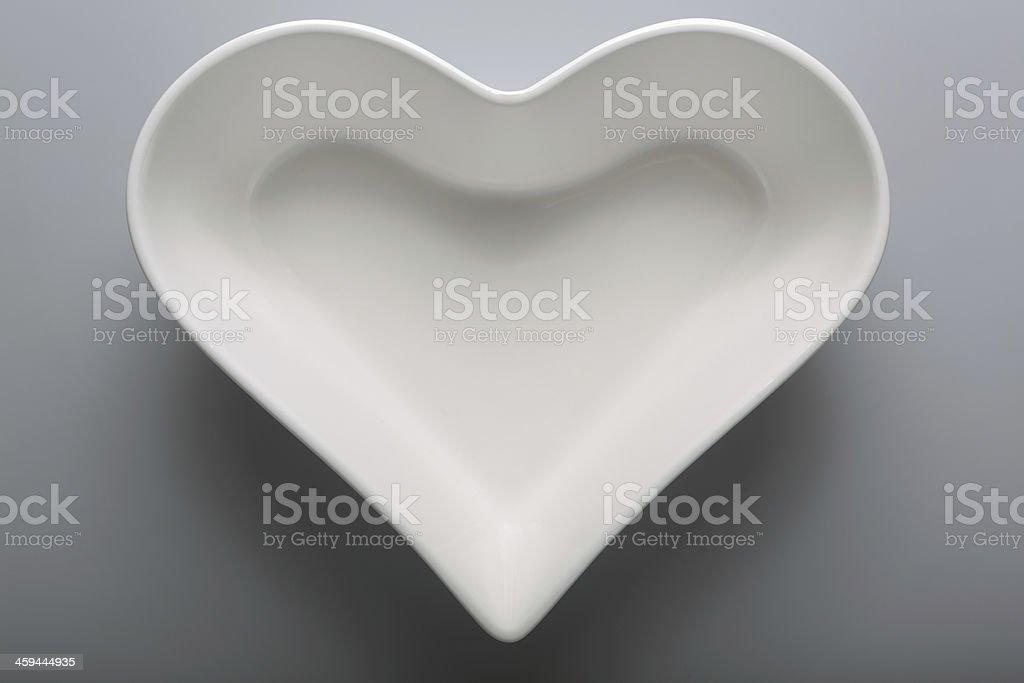Empty, white plate in heart shape stock photo