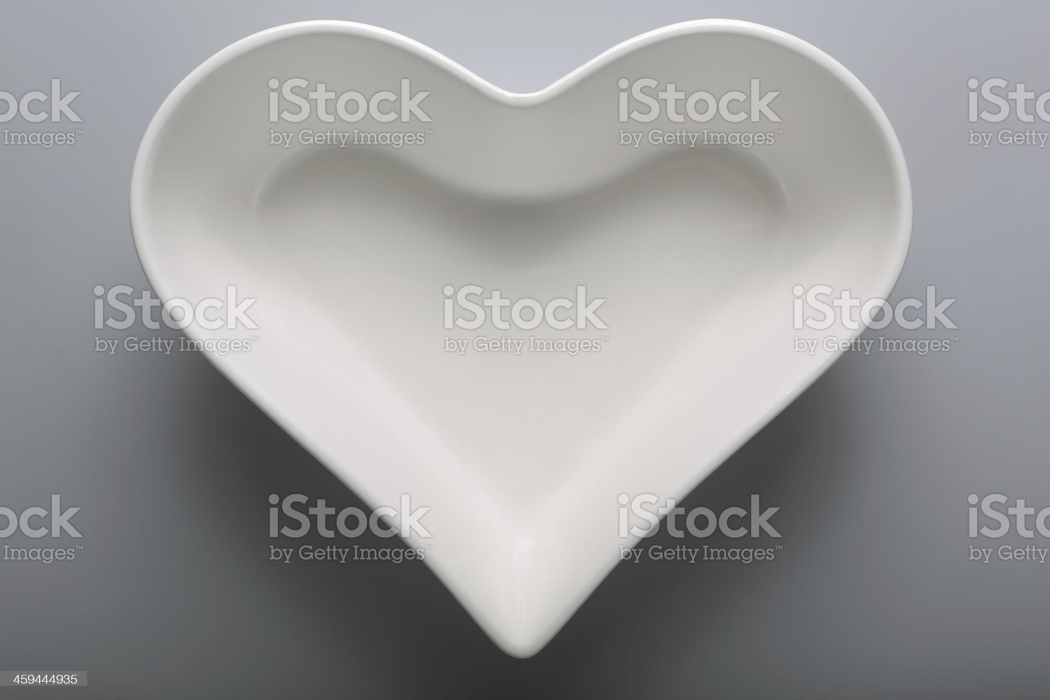 Empty, white plate in heart shape royalty-free stock photo