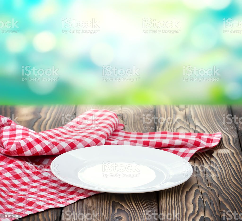 Empty white plate on wood nature blur background. stock photo
