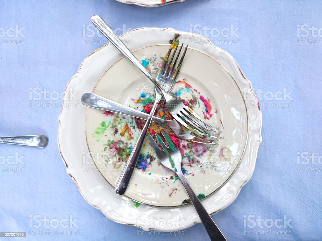 Empty white plates and fork with traces of eaten pie stock photo