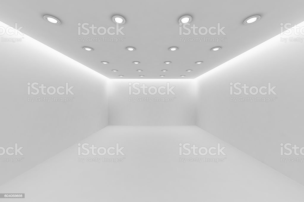 Empty white room with small round ceiling lamps. stock photo