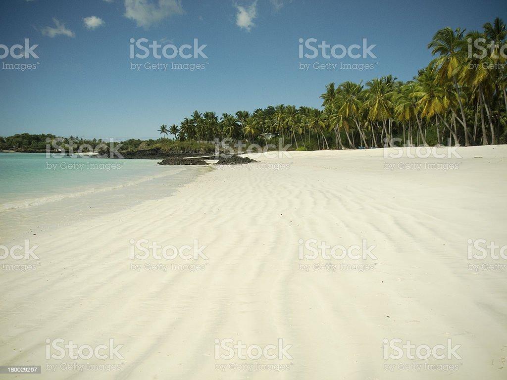 Empty white sand beach on paradise island stock photo