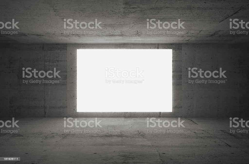 Empty white screen glows in dark abstract concrete room interior royalty-free stock photo