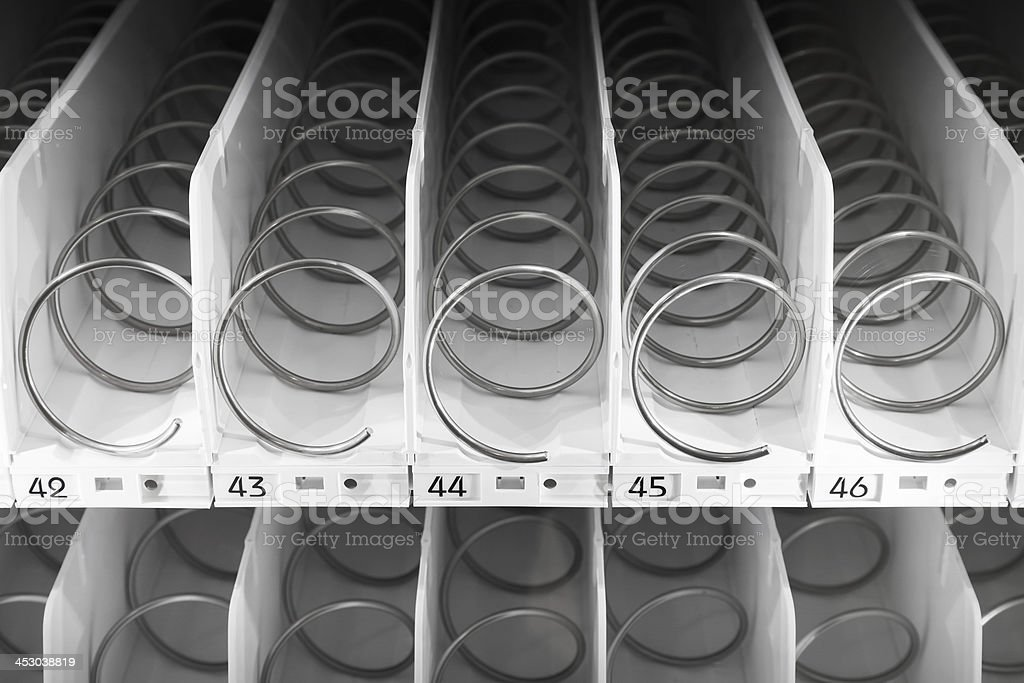 Empty white shelf of standard office vending machine stock photo