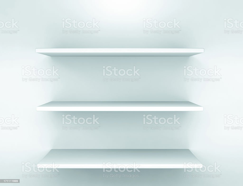 Empty white shelves stock photo