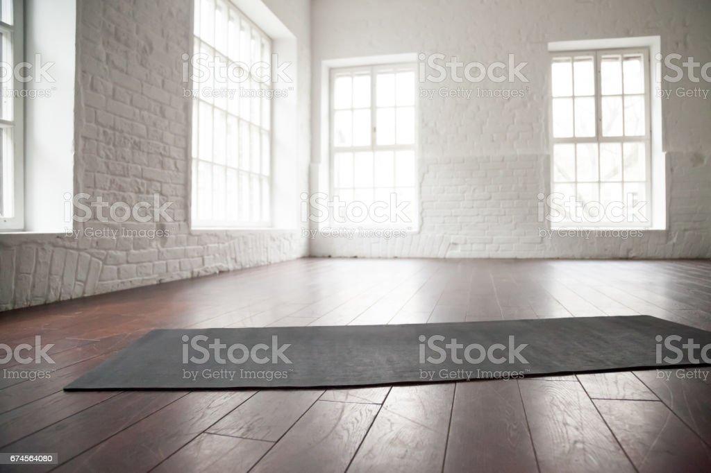 Empty white space, loft studio, yoga mat on the floor stock photo