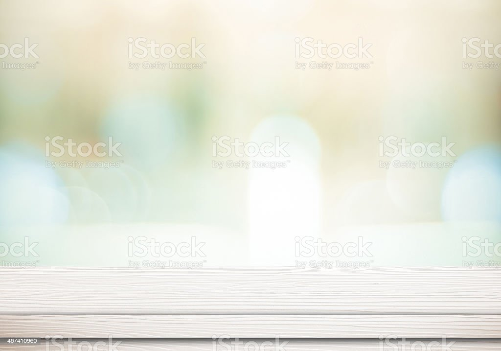 Empty white table and blurred store bokeh background stock photo