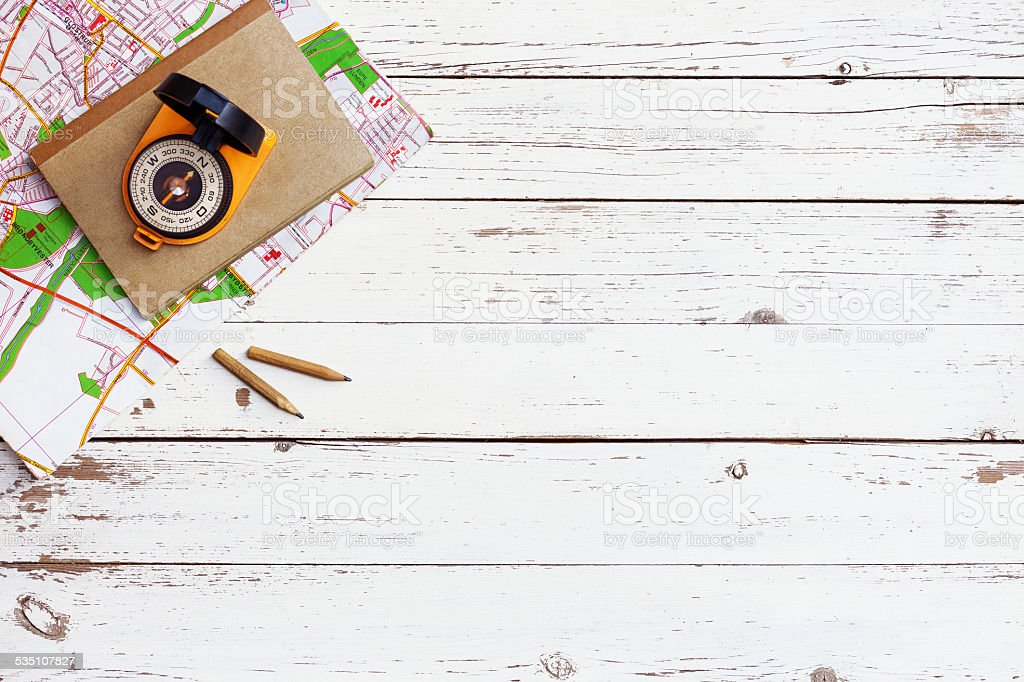 empty white wooden table with tools for adventure and travelling stock photo