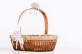 Empty wicker basket on wooden table