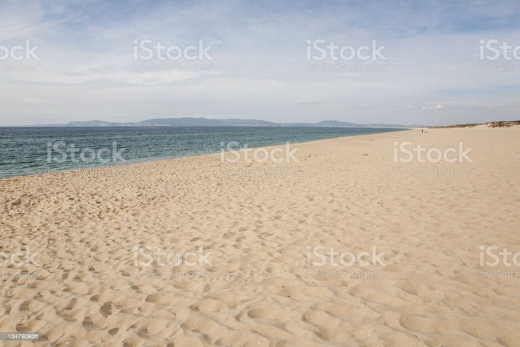 Empty wide beach in Portugal stock photo