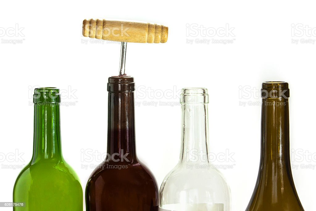Empty wine bottles and one corked on white stock photo