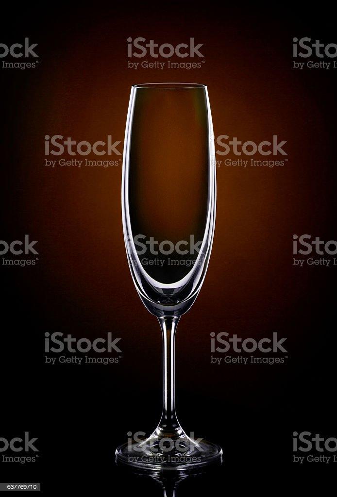 Empty wine glass on dark red stock photo