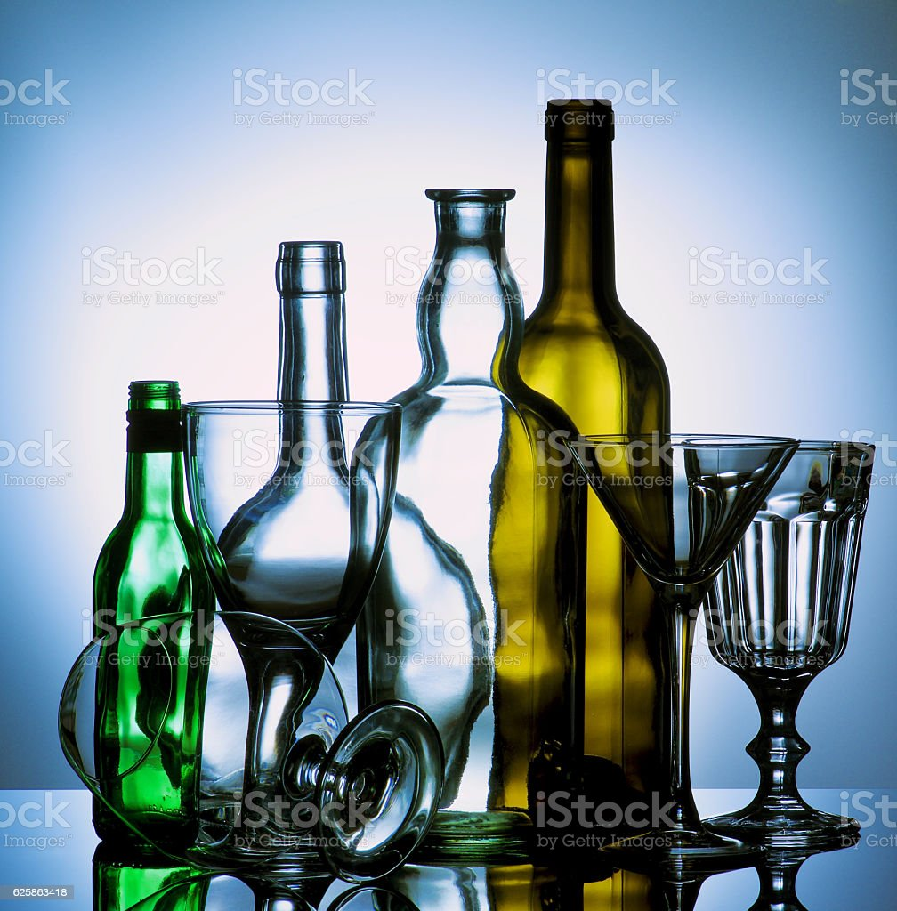 Empty Wine Glasses and Bottles stock photo