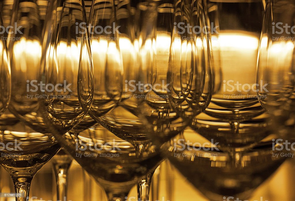 Empty wine glasses in golden backlight royalty-free stock photo