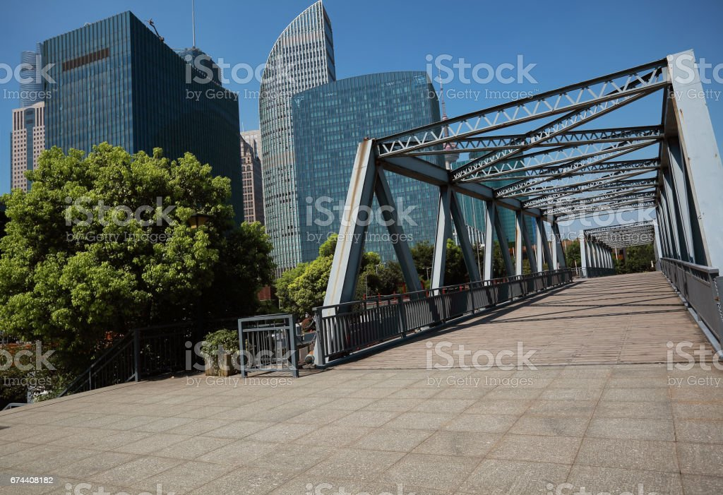 Empty wood floor road of the Front of the ironbridge with City buildings in Shanghai stock photo