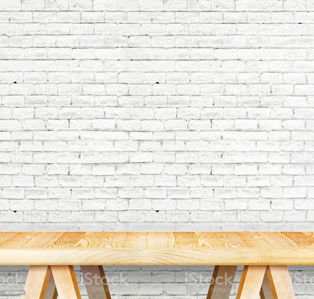 Empty wood modern table and grunge white brick wall stock photo