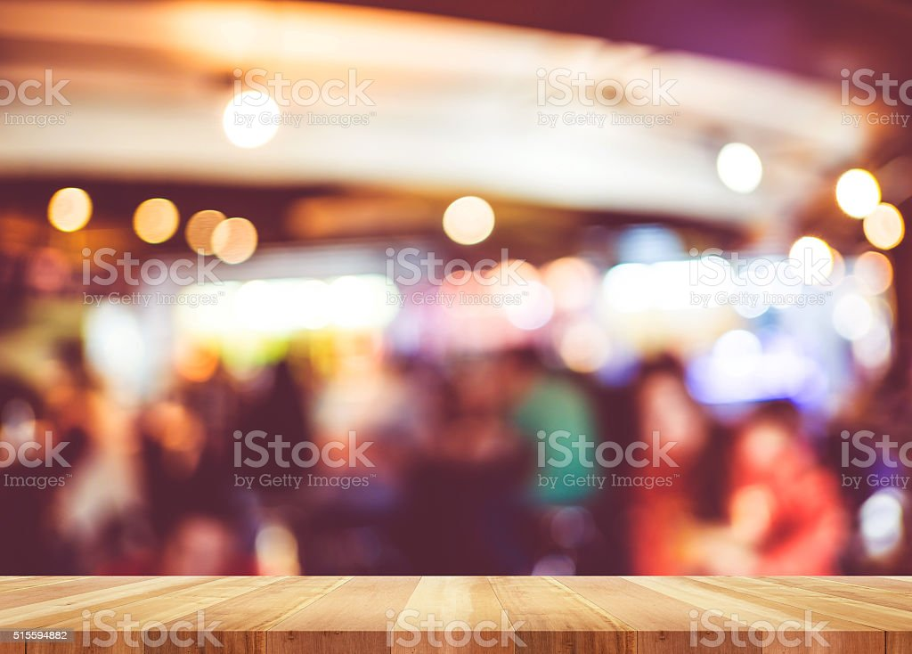 Empty wood table and blurred cafe light background. Business pre stock photo
