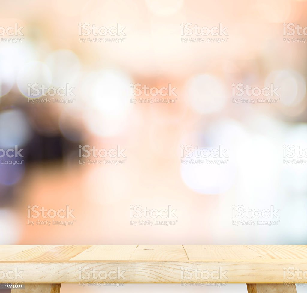 Empty wood table and blurred cafe light background. product disp stock photo
