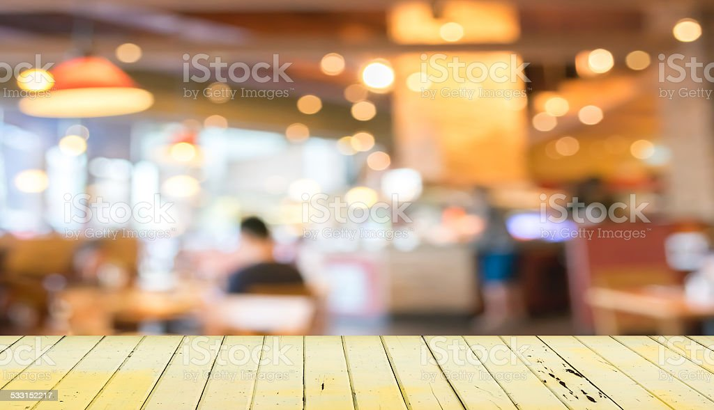 Empty wood table and blurred coffee shop  background. stock photo