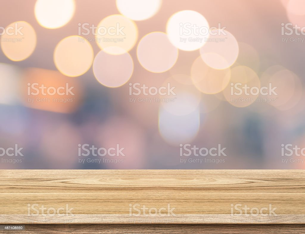 Empty wood table and blurred vintage bokeh light background. pro stock photo