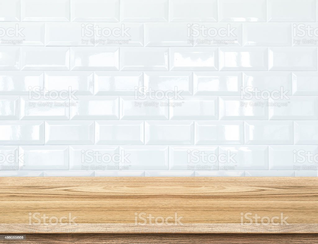 Empty wood table and  white ceramic tile brick wall stock photo