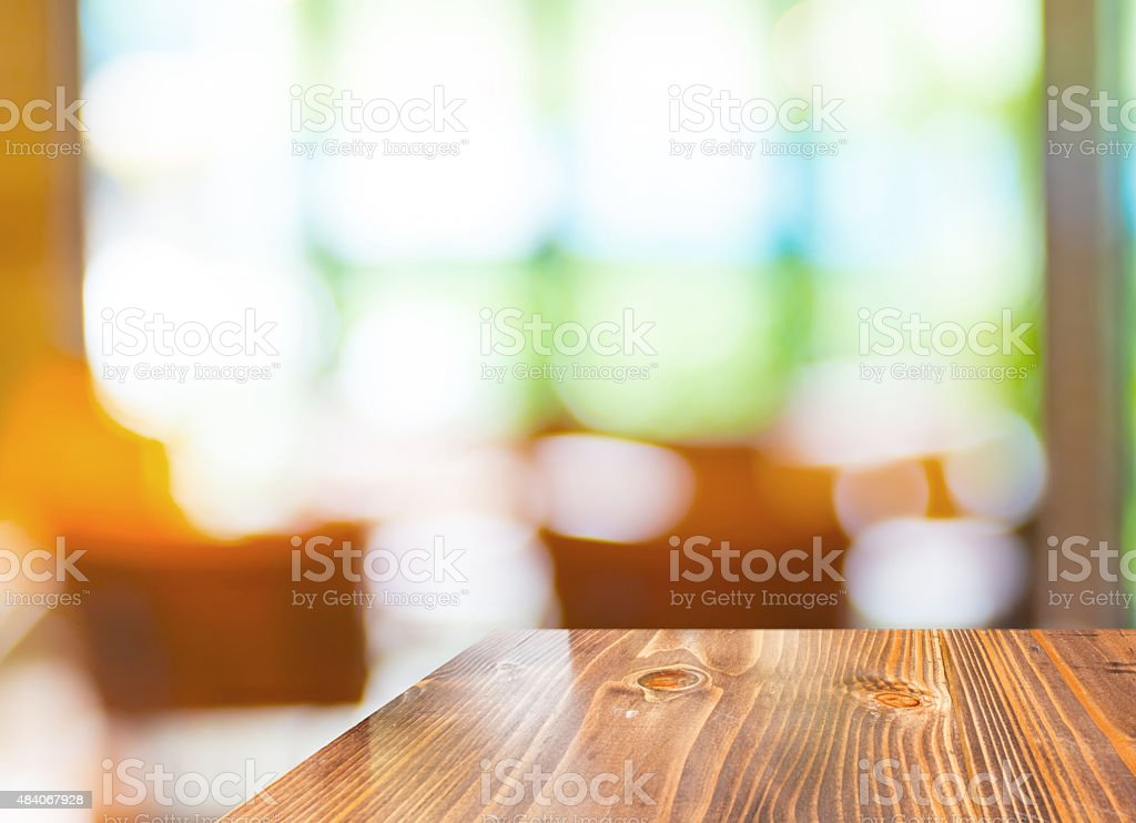 Empty wood table at blurred garden cafe background,Template mock stock photo