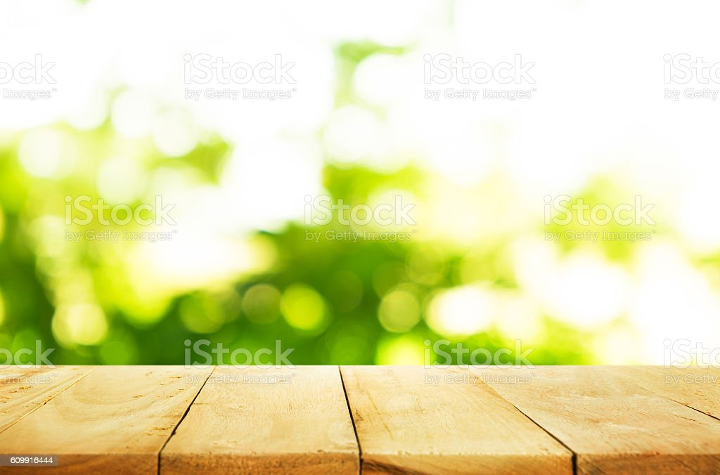 Kitchen Table Top Background empty wood table top on blur of fresh green background stock photo